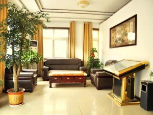 Qingdao Youxin Aviation Apartment Hotel