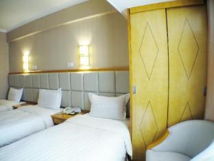 Fu Hua Guang Dong Hotel Macao - Hotellihuone