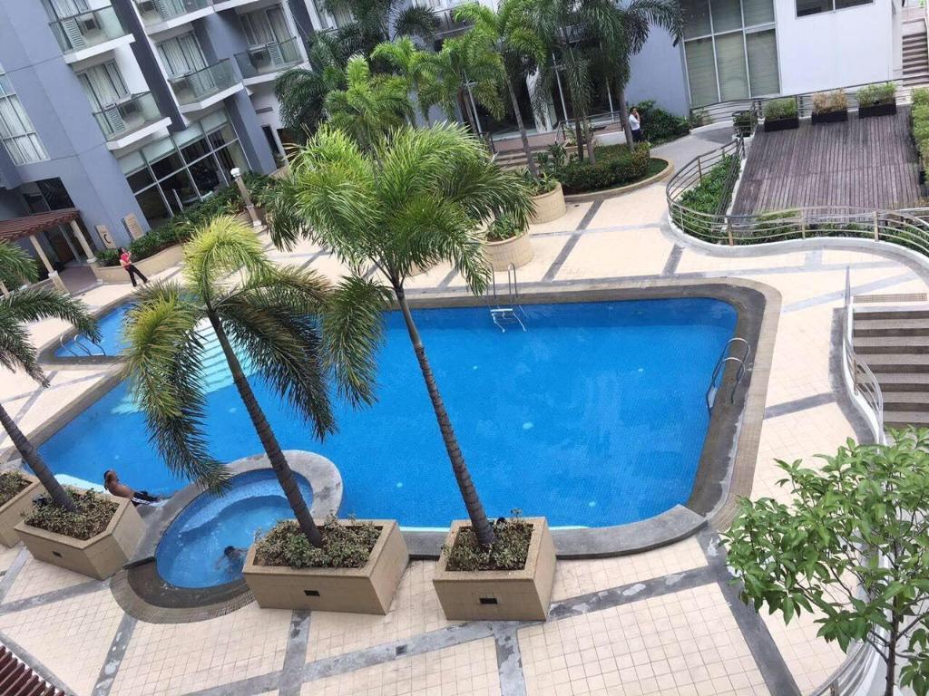 H r management one palm tree villas for Palm tree villas 1