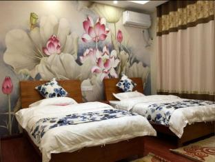 /de-de/zhangjiajie-pandora-inn-tianmenshan-branch/hotel/zhangjiajie-cn.html?asq=jGXBHFvRg5Z51Emf%2fbXG4w%3d%3d