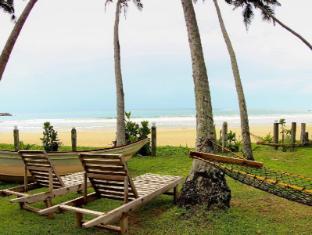 /bg-bg/dickwella-beach-hotel/hotel/tangalle-lk.html?asq=jGXBHFvRg5Z51Emf%2fbXG4w%3d%3d