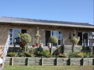 /ar-ae/milkwood-on-main-bed-and-breakfast-and-self-catering/hotel/east-london-za.html?asq=jGXBHFvRg5Z51Emf%2fbXG4w%3d%3d
